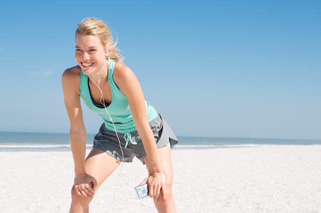 Woman exercizing on a beach