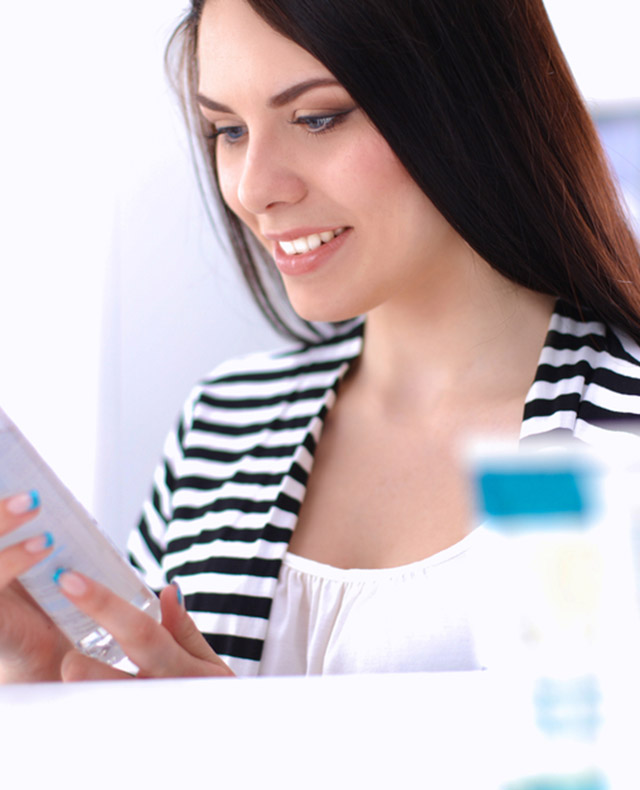 Woman at Beauty Counter examining NEUTROGENA® products